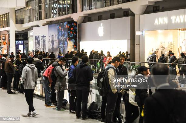 Crowds line up for the new iPhone X at Apple Store Eaton Centre on November 3 2017 in Toronto Canada