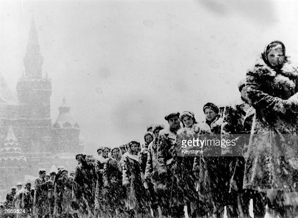 Crowds line up in the freezing snow at Red Square Moscow to visit Lenin's tomb