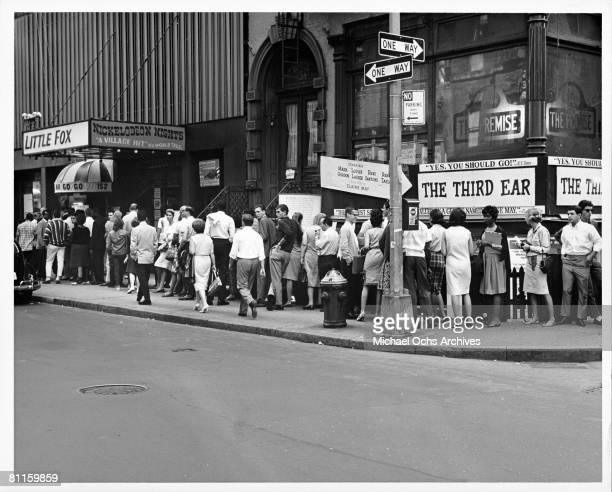 Crowds line up outside of The Little Fox Theatre and The Cafe Au Go Go at 152 Bleecker Street in Greenwich Village circa 1965 in New York City New...