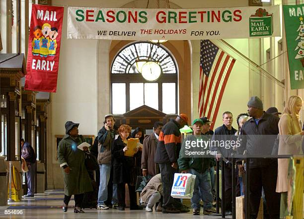 Crowds lineup at a US Post Office December 17 2001 in New York City on what is traditionally the busiest day of the year for mail With Christmas only...