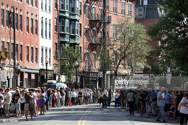 Crowds lining Hanover Street await the motorcade with the hearse bearing the coffin of US Sen Edward Kennedy August 27 2009 in the North End of...