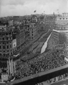Crowds lining Trafalgar Square watch HRH Queen Elizabeth II's coronation procession passing 2nd June 1953