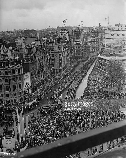 Crowds lining Trafalgar Square watch HRH Queen Elizabeth II's coronation procession passing 2nd June 1953