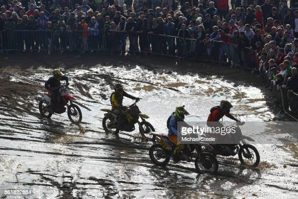 Crowds look on at silhouetted riders during the Adult Solo race during day two of the HydroGarden Weston Beach Race on October 15 2017 in...