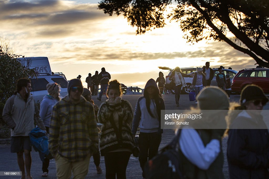 Crowds make their way through the car park at dawn at the Rip Curl Pro on April 1, 2013 in Bells Beach, Australia.