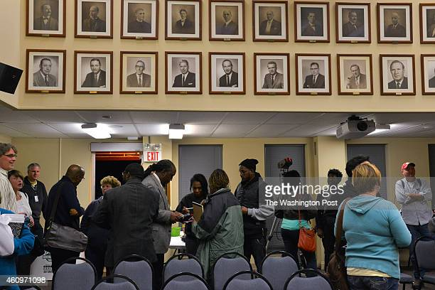 Crowds mingle following a Ferguson City Council meeting on Monday November 10 in Ferguson MO The St Louis suburbs are bracing for the outcome of the...