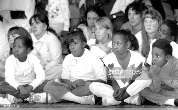 Crowds of children and adults black and white crowded the Denver Museum of natural history to watch and hear Opalonga Pugh tell them stories with...