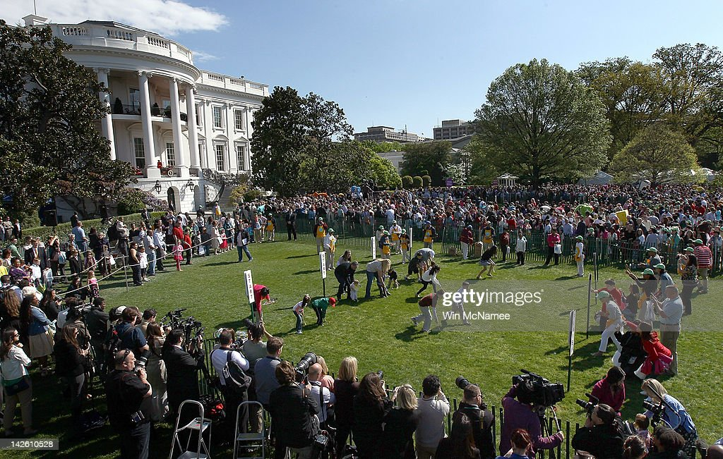 Crowds of children and their families take part in the White House Easter Egg Roll on the South Lawn of the White House April 9, 2012 in Washington, DC. Thousands of people people are expected to attend the 134-year-old tradition of rolling colored eggs down the White House lawn that was started by President Rutherford B. Hayes in 1878.