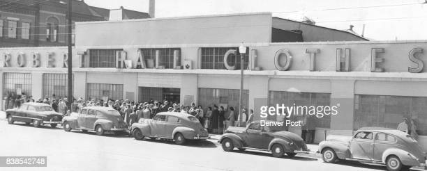 Crowds of Denver buyers line up outside the new Robert Hall clothes store at 600 Thirteenth street corner of Welton street Thursday after fullpage...