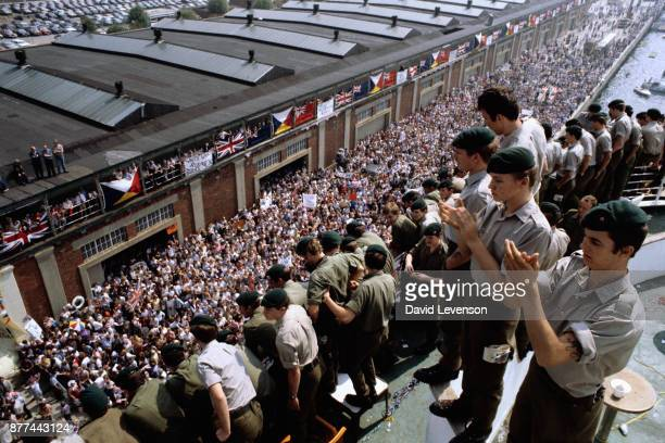 Crowds of family and civilians welcome the return of Royal Marines aboard the SS Canberra as it docks in Southampton on July 11 on their return from...