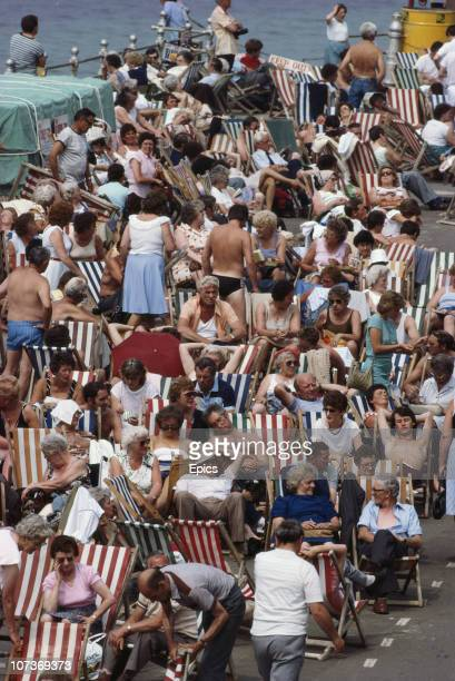 Crowds of holidaymakers relaxing in deckchairs in the seaside resort of Blackpool Lancashire August 1983