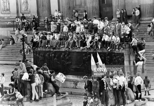 Crowds of Liverpool fans gathered on the Centoph outside St George's Hall in Liverpool City Centre waiting to welcome their heroes home following...