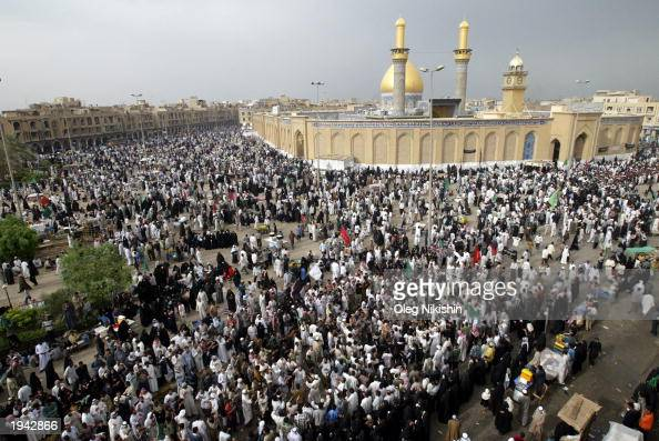 Crowds of Muslim Shias make a religious pilgrimage by walking to and around the mosques of Imam Abbas and Imam Hussein April 21 2003 in Karbala Iraq...