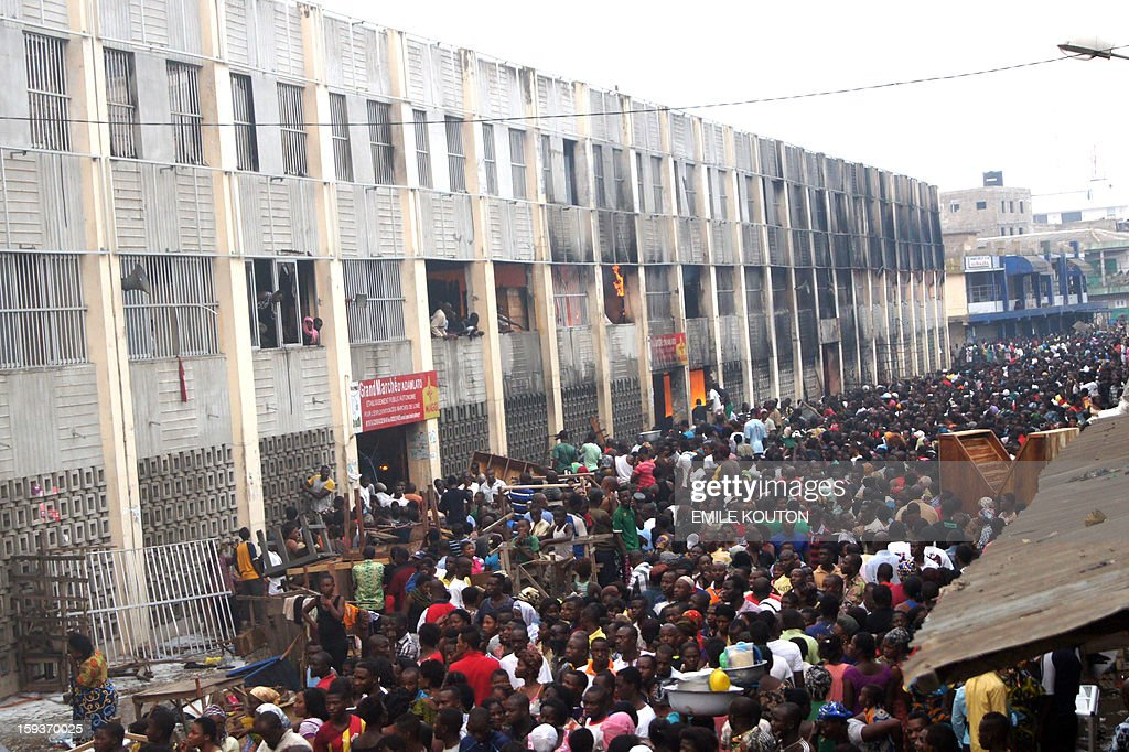 Crowds of people filled the streets surrounding a still burning Lome Grand Marche (''Lome Big Market'') on January 12, 2013 in Lome. Several people entered the burning to save their goods.