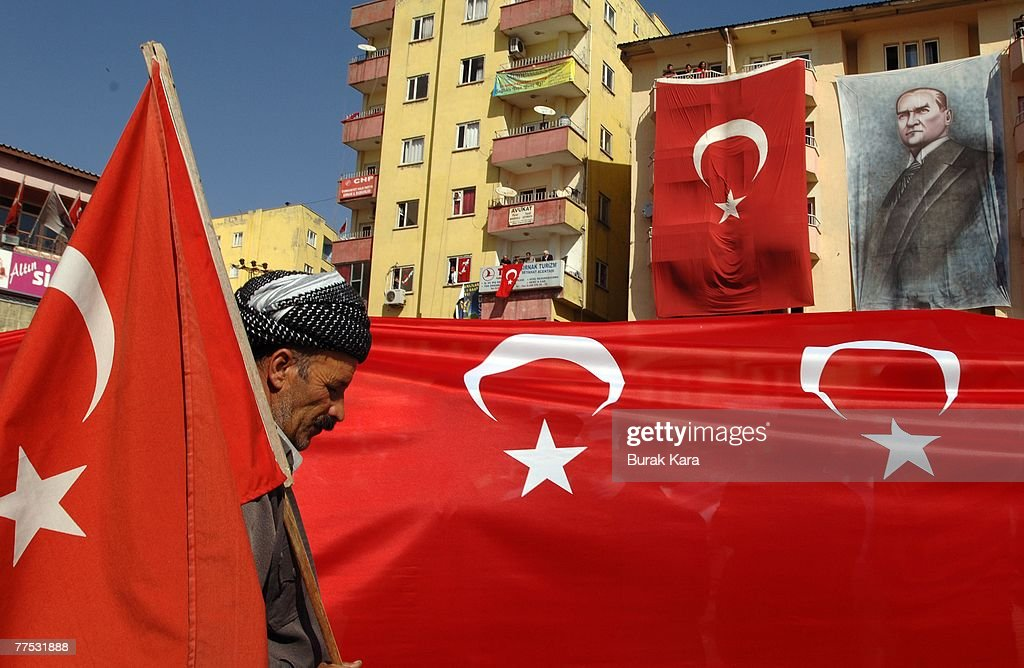 Crowds of people gather in dowtown Sirnak city with banners and Turkish flags to protest against the outlawed Kurdistan Workers Party on October 27...