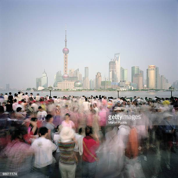 crowds of people in front of Pudong Skyline.