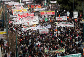 Crowds of people march through the streets during a 24hour general strike on February 24 2010 in Athens Greece Greece ground to a halt and flights...