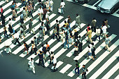Crowds of people pedestrian crossing, high angle view