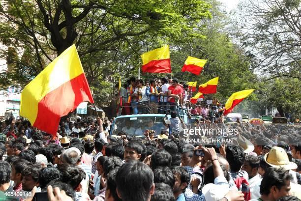 Crowds of people surround Kannada film artists and fraternity members as they take out a rally in protest against the dubbing culture in Sandalwood...