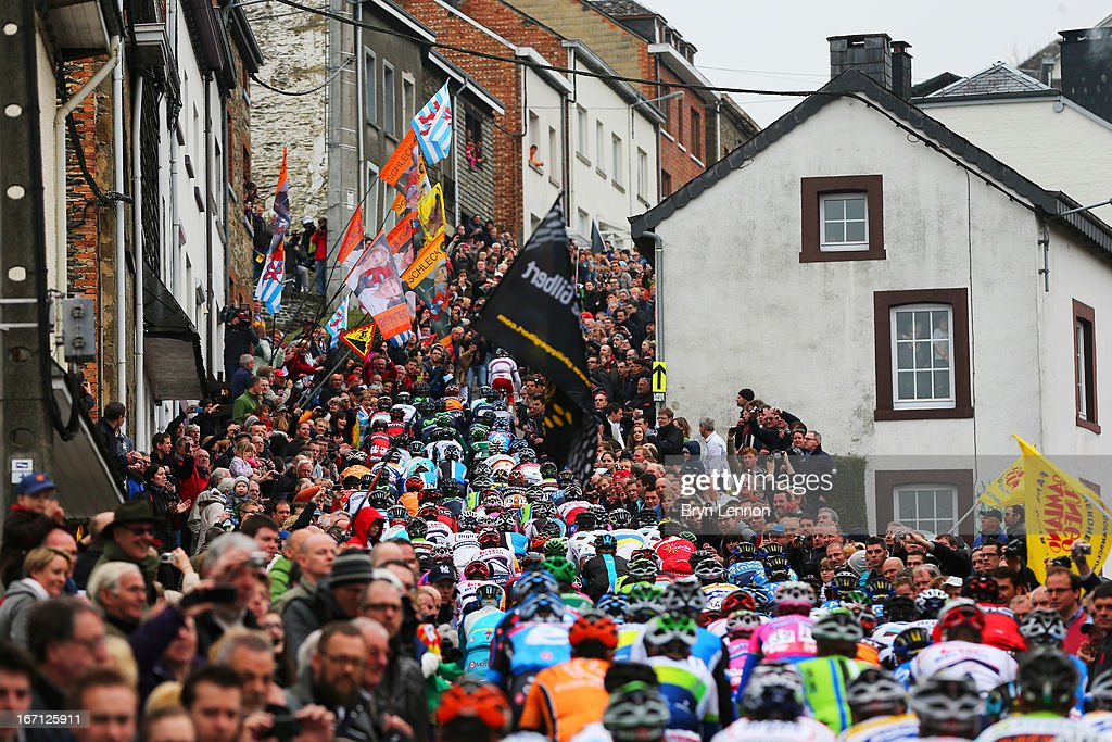 Crowds of people watch as the peloton climbs the Cote de Saint-Roch during the 99th Liege-Bastogne-Liege cycle road race on April 21, 2013 in Ferrieres, Belgium.