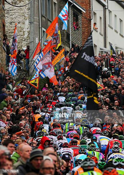 Crowds of people watch as the peloton climbs the Cote de SaintRoch during the 99th LiegeBastogneLiege cycle road race on April 21 2013 in Ferrieres...