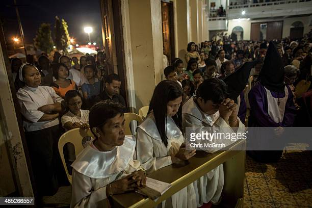 Crowds of people watch on from outside of the Palo Cathedral during the Maundy Thursday mass on April 17 2014 in Palo Leyte Philippines Maundy...