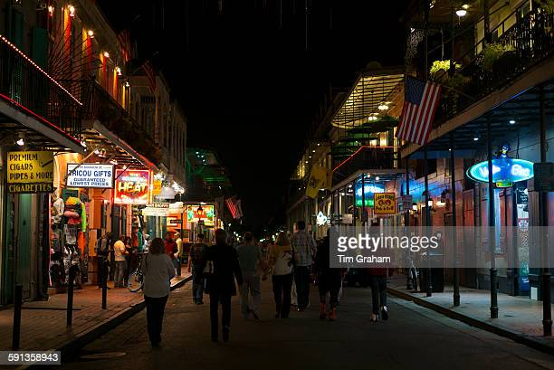 Crowds of revellers in famous Bourbon Street in French Quarter of New Orleans USA