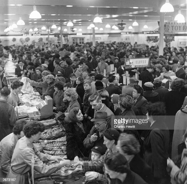 Crowds of shoppers inside a large Marks Spencer's store demonstrating that the new culture of shopping has sacrificed personal service for efficiency...