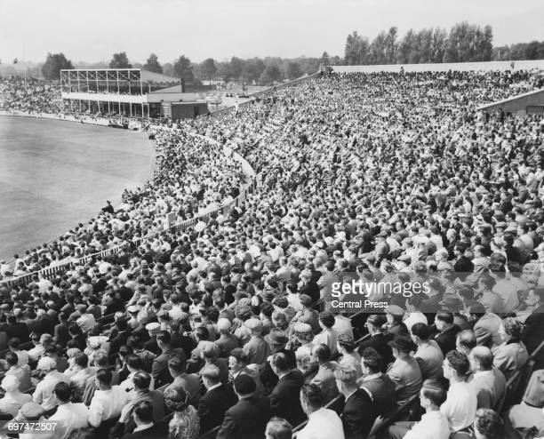 Crowds of spectators in the grandstand and the Pavilion look on during the third day of the first Test match of the series between England and the...
