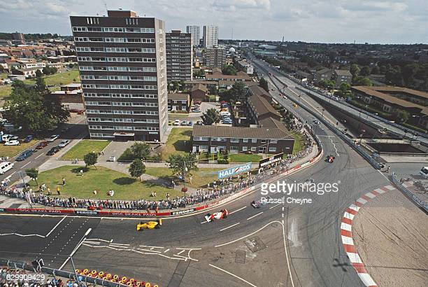 Crowds of spectators watch the race action as Eddie Irvine drives the Eddie Jordan Racing Reynard 90D Smith Mugen through the streets during the FIA...