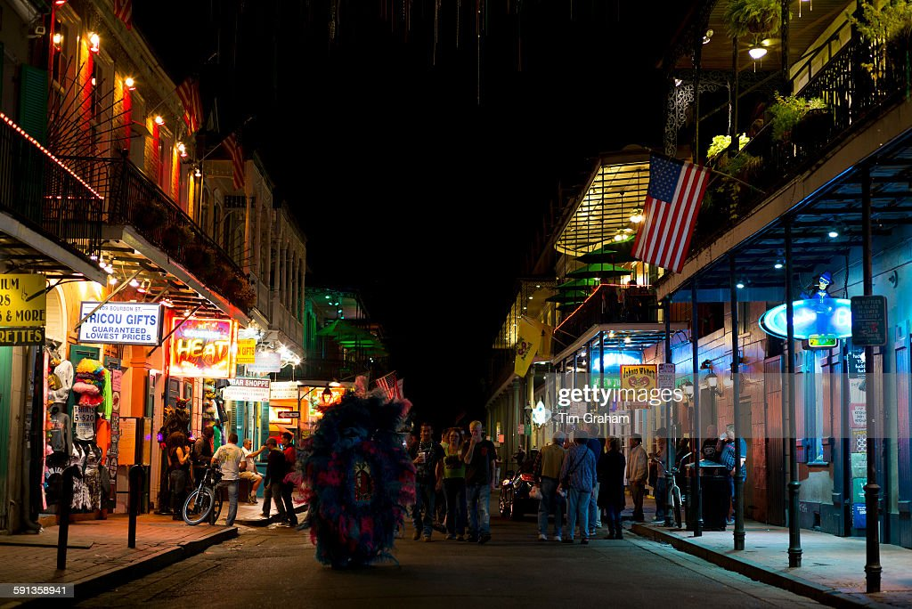 Crowds of tourists in crowded famous Bourbon Street in French Quarter of New Orleans USA