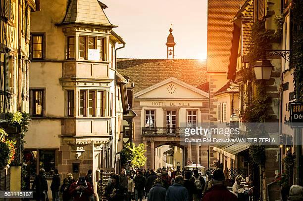 Crowds of tourists in quaint village on route des vins dAlsace, France