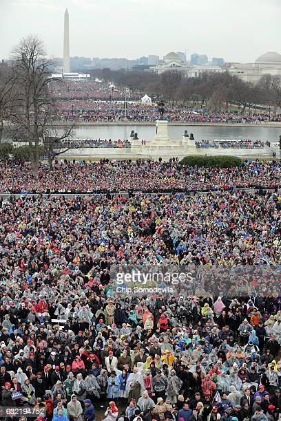 Crowds on the National Mall and in front of the US Capitol watch US President Donald Trump deliver his inaugural address on the West Front of the US...