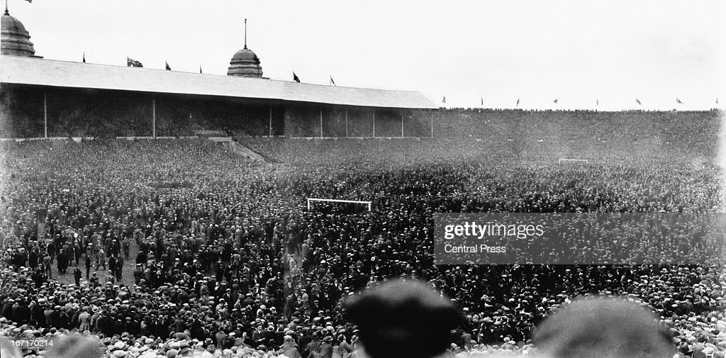Crowds on the pitch during the FA Cup Final between Bolton Wanderers and West Ham United, 28th April 1923. This was the first FA Cup Final at Wembley and it was estimated 200,000 spectators got into the grounds. Eventually the the pitch was cleared and the match got under way 44 minutes late. Bolton Wanders went on to win the game 2 - 0.