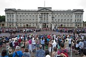 Crowds outside Buckingham Palace watch as guardsmen take part in the Changing of the Guard in central London on July 23 2013 International messages...