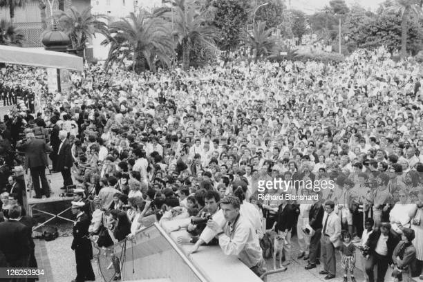 Crowds outside the Palais Des Festivals or Festival Palace during the Cannes Film Festival in France circa 1988
