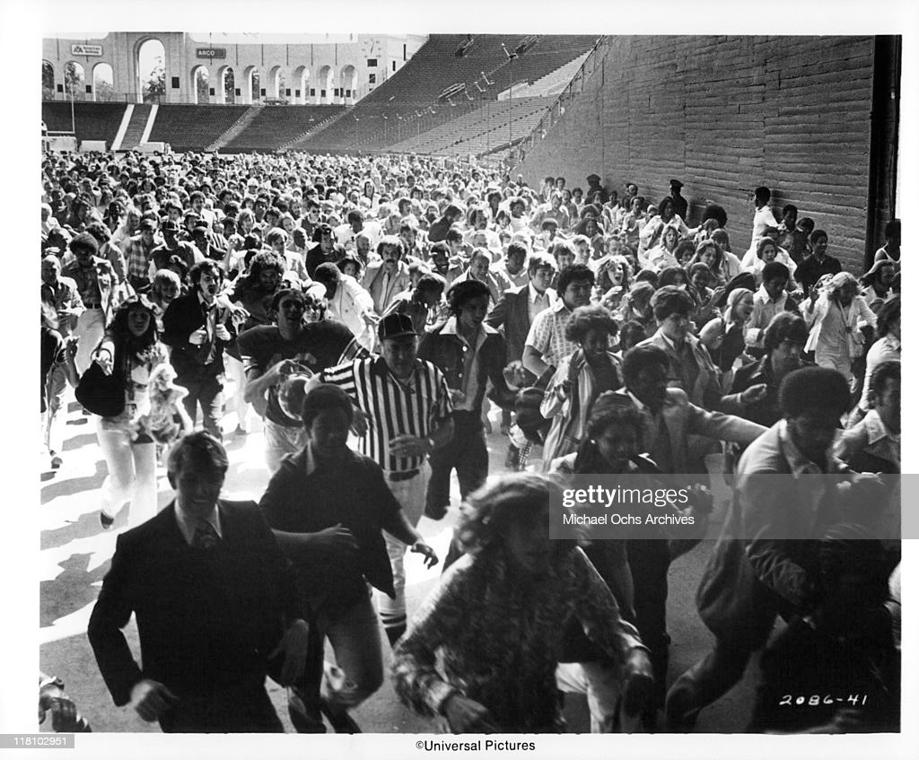 Crowds panic and rush onto the football field at Los Angeles Coliseum in a scene from the film 'TwoMinute Warning' 1976
