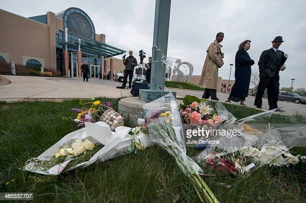 Crowds pass by a makeshift memorial following an interfaith service honoring victims of Sunday's shootings on April 17 2014 at the Jewish Community...