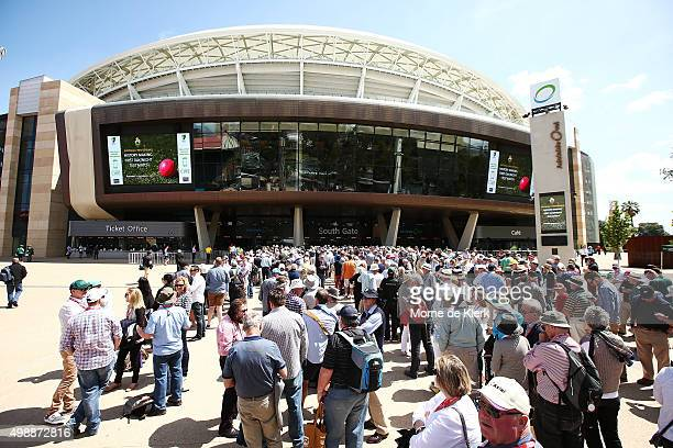 Crowds queue at the southern gate before day one of the Third Test match between Australia and New Zealand at Adelaide Oval on November 27 2015 in...