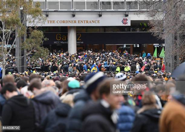 Crowds queue to enter the MCG during the AFL Second Qualifying Final Match between the Geelong Cats and the Richmond Tigers at Melbourne Cricket...