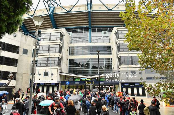 crowds queue to enter the MCG during the round five AFL match between the Essendon Bombers and the Collingwood Magpies at Melbourne Cricket Ground on...
