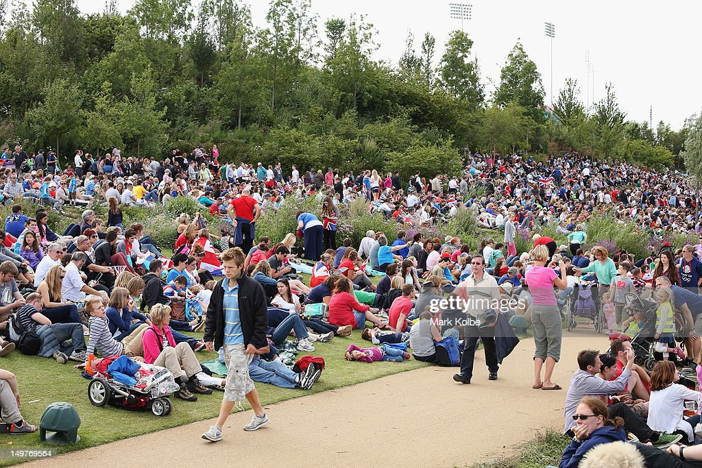 Crowds sit in the park to watch a live screen in the Olympic Park on day six of the London 2012 Olympic Games at the Olympic Parkon August 2, 2012 in London, England.