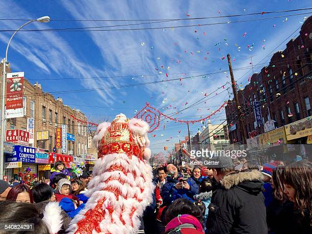 Crowds surround the Lion Dragon Dancers and confetti is launched into the air at the Chinese New Years Parade Festival in the Chinatown section of...