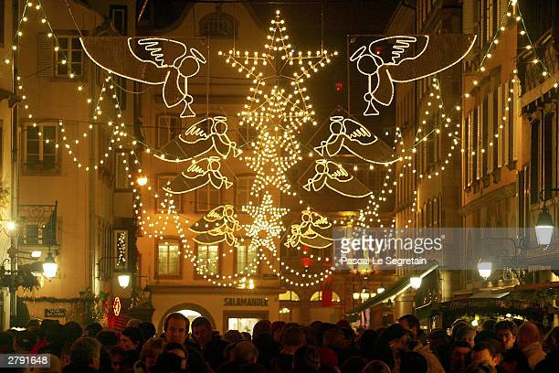 Crowds throng Cathedral Square during the annual traditional Christmas market on December 6 2003 in Strasbourg France