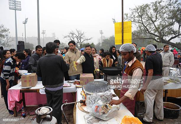 Crowds throng the National Street Food Festival at Jawaharlal Nehru Stadium in New Delhi on December 21 2013 Over 100 vendors are participating in...