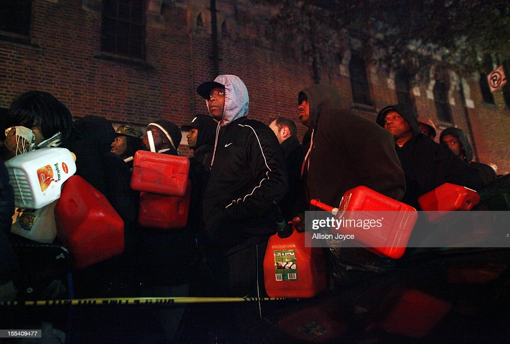 Crowds wait for free gas November 3, 2012 at the Bedford Avenue Armory in the Brooklyn borough of New York City. With the death toll currently over 90 and millions of homes and businesses without power, the US east coast is attempting to recover from the effects of floods, fires and power outages brought on by Superstorm Sandy.