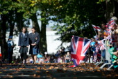 Crowds wait for Prince William Duke of Cambridge and Catherine Duchess of Cambridge to arrive at the Cambridge Town Hall on April 12 2014 in...
