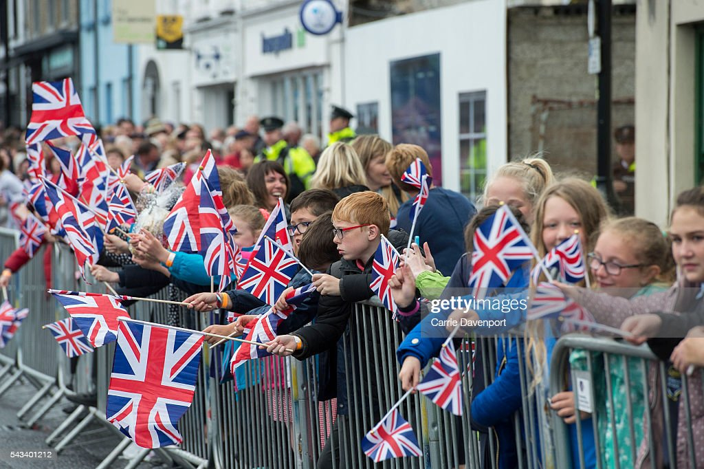 Crowds wait for the arrival of Queen Elizabeth II & Prince Philip, Duke Of Edinburgh to attend the unveiling of the Robert Quigg VC memorial statue in Bushmills village on June 28, 2016 in Bushmills, Northern Ireland.
