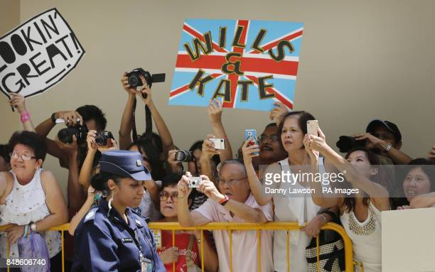 Crowds wait for the Duke and Duchess of Cambridge during a visit to Strathmore Green Queenstown Housing Estate in Singapore as part of a nineday tour...