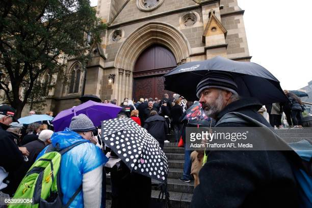 Crowds wait outside to enter during the former Collingwood legend Lou Richards state funeral at St Paul's Cathedral on May 17 2017 in Melbourne...